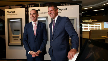 Former premier Mike Baird, pictured with former NAB chief Andrew Thorburn, upon joining the bank in April 2017.