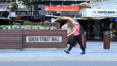 People wear face masks in Queen Street Mall in the Brisbane CBD after Premier Annastacia Palaszczuk announced a three-day lockdown for Brisbane.