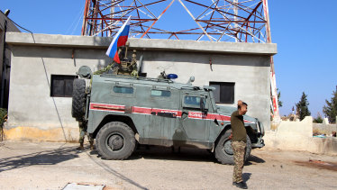 Russian forces armored vehicles patrol the Syrian border in Kobani.