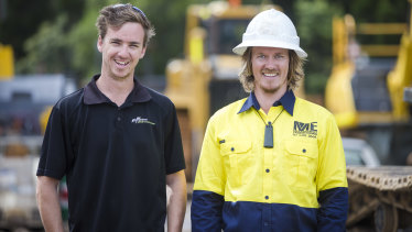 Former brickie Ben Roche (left, pictured with boss James McManaway) is recovering from a serious brain injury and is now driving trucks.
