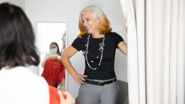 Marcia Scott, trying on an outfit at Fitted for Work, is one of thousands of recipients of quality work clothes, handbags and shoes donated by corporate women to help those seeking work to look the part every International Women's Day.