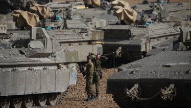 Israeli soldiers prepare their armoured vehicles at a gathering point near the Israel-Gaza Border on Wednesday.