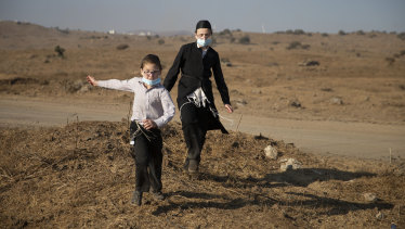 Ultra-Orthodox Jews wearing protective face mask amid concerns over the country's coronavirus outbreak.