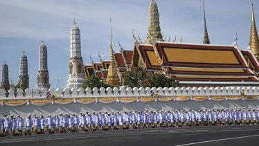 Thai officers stand outside the Grand Palace in Bagkok ahead of King Maha Vajiralongkorn's coronation.