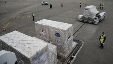 Medical supplies and materials are loaded into a cargo plane to India at Roissy airport, north of Paris on Saturday.