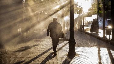 A pedestrian walks through tear gas during a protest in Santiago on Friday.