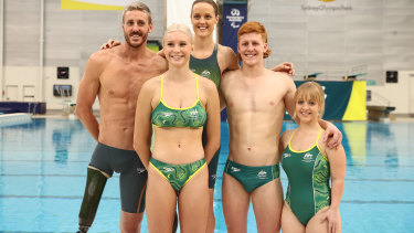 Members of the Australian Paralympics swimming team, from left, Brenden Hall, Keira Stephens, Ellie Cole, Col Pearse and Tiffany Thomas Kane at their uniform launch for the Tokyo Games at Sydney Olympic Park on Thursday.