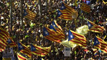 Demonstrators wave esteladas (independence flags) in Barcelona on Sunday.