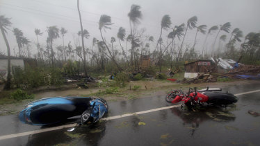 Motorcycles lie on a street in Puri, Odisha state, India, after Cyclone Fani made landfall on Friday.