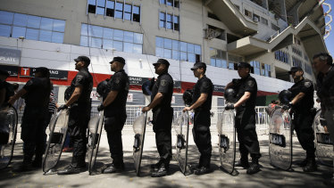 Riot police outside the stadium where the Copa Libertadores final was to be held.