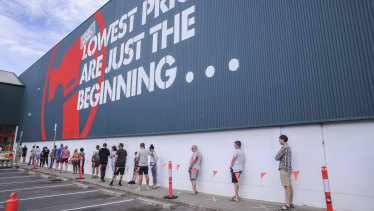 Shoppers practice social distancing outside a Bunnings store in Croydon on Sunday.