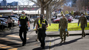 Victoria police and ADF personnel patrolling Melbourne CBD during the stage four lockdown.