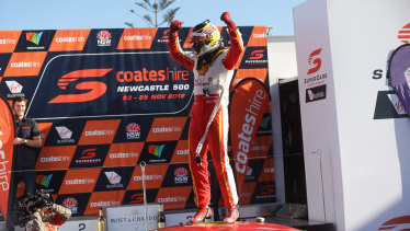 Champion: Scott McLaughlin celebrates on his car after clinching the Supercars title.