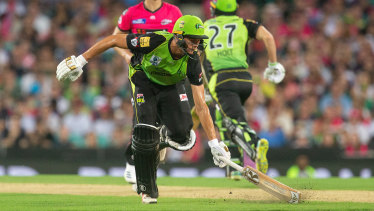 Safe: Chris Green makes his ground against the Sixers earlier in the campaign.