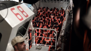 Migrants about to board the SOS Mediterranee's Aquarius ship and MSF (Doctors Without Borders) in the Mediterranean Sea.
