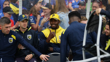 Main attraction: Usain Bolt in the dugout with the Mariners in Maitland.