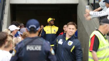 Star power: Usain Bolt enters Maitland Sports Ground.