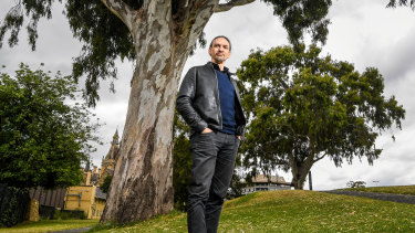 Indigenous architect Jefa Greenaway by the ancient river red gums at the University of Melbourne. Before European contact, it was a place of streams and billabongs.