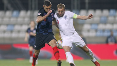 Stalemate: England's Harry Kane, right, and Croatia's Antonio Milic vie for the ball.