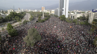 Demonstrators protest against the government in Santiago, Chile, again on Monday.