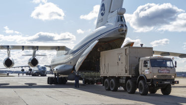 A military truck loads on board of an Il-76 cargo plane in Chkalovsky military airport outside Moscow, Russia.