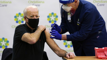 Focused: President-elect Joe Biden receives his second dose of the coronavirus vaccine from Chief Nurse Executive Ric Cuming in Newark on Monday.