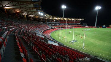 Round one action at Gold Coast's Metricon Stadium - without spectators.