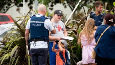 Police talking to a family, believed involved in several incidents across Auckland at the weekend, at Burger King Te Rapa.