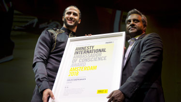 Former NFL quarterback Colin Kaepernick receives the award.