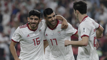 Another one: Iran's forward Mehdi Taremi, centre, celebrates after scoring his side's opening goal against Yemen.