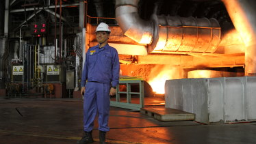 A worker poses at the South Korean POSCO factory in Gwangyang, South Korea.