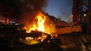 Demonstrators set up a burning barricade on the Champs-Elysees avenue during a demonstration against the rising of the fuel taxes on Saturday.