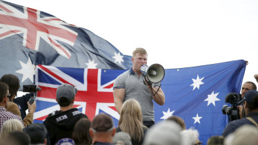 Right-wing extremist Blair Cottrell addresses the rally.