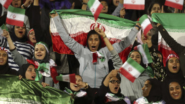 Iranian women cheer for their team in October 2018, in a rare case of women being allowed into a stadium to watch soccer in the country.