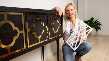 Kylie Hughes with one of the Ikea cabinets she has refurbished.