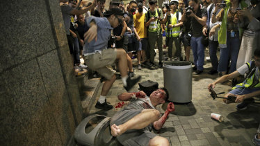 A man hits a suspected attacker after an incident broke out outside a Hong Kong mall.