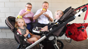 Shadow spokesperson for Northern Australia, Senator Murray Watt, and Opposition Leader, Anthony Albanese, on a tour of regional Queensland. They are pictured with Biloela children Ivyanne Millwood, 3, and her brother, Jack, 1.