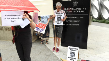 Supporters outside the inquest into Omid Masoumali's death in Brisbane on Monday.