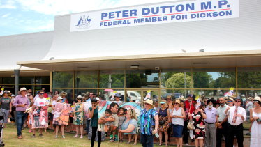 Supporters of the family rally outside Peter Dutton's electorate office in January.
