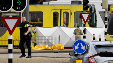 Rescue workers are installing a screen on the scene following a shooting in Utrecht, Netherlands.