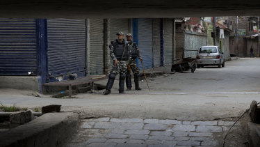 Indian paramilitary soldiers stand guard at a closed market in central Srinagar, Indian controlled Kashmir, on Tuesday.