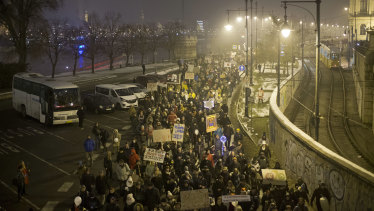 Protesters walk along a street during an anti-government march in central Budapest, Hungary.