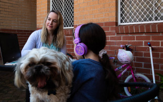 Hilary Brainard, her daughter Emerson and dog Teddy have been living and working through screens during Sydney's lockdown.