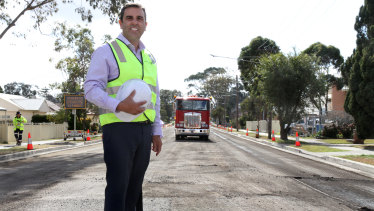 Sutherland Shire Mayor Carmelo Pesce at the stretch of the Old Princes Highway where a recycled road will be laid on Friday.