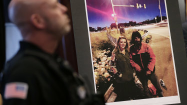 A picture of Katelyn McClure and Johnny Bobbitt is displayed during a police news conference.