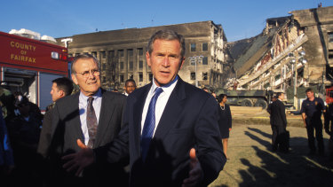 President George W. Bush and Secretary of Defence Donald Rumsfeld visit the Pentagon to view the damage the day after the September 11, 2001 terrorist attacks. The economic repercussions of the attacks continue to reverberate.