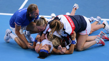 True Blues: A delighted French team celebrate after Caroline Garcia and Kristina Mladenovic won the deciding doubles match against Australia's Ashleigh Barty and Samantha Stosur.