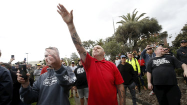 A protester issues a Nazi salute.