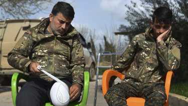 Sipan Abdulrahman Khadir (left) who lost the lower part of his left leg in Baghouz reapplies the bandage to his leg as Sipan Ezzo, 20, looks on. Ezzo lost both legs and his right hand and part of his arm.