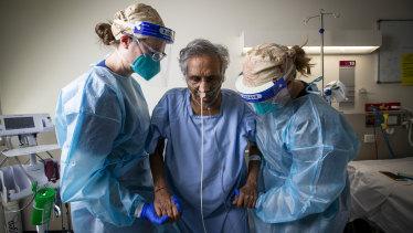 COVID 19 survivor ViswanathanNair and ICU physiotherapists Kimberley Haines (right) and Nina Leggett at Footscray Hospital.